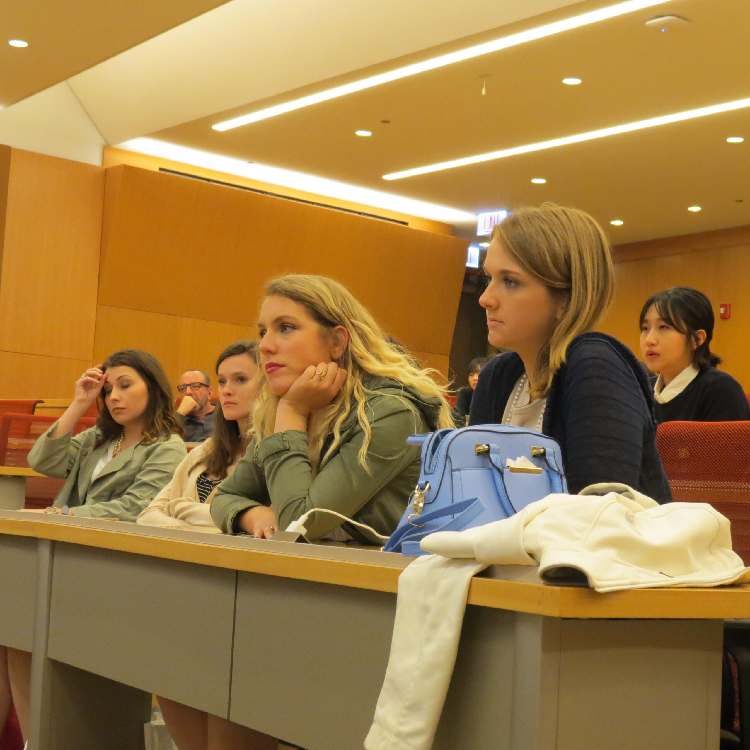 students listen to presentation in lecture hall