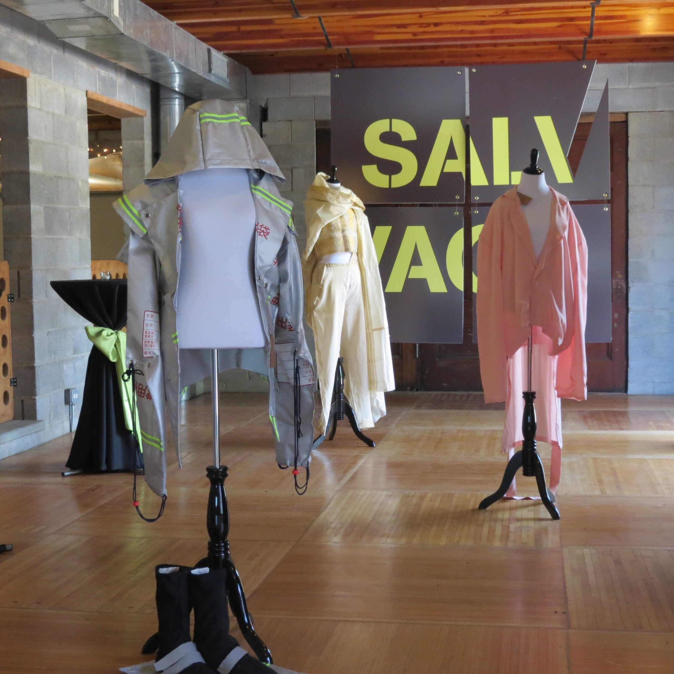 three dressed up mannequins spaced within a room with