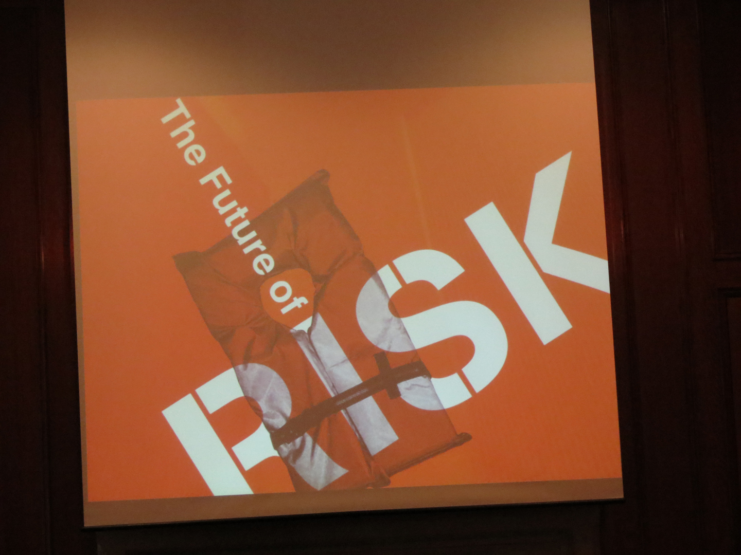 a photo of the poster for the 2012 Future of Risk symposium on display