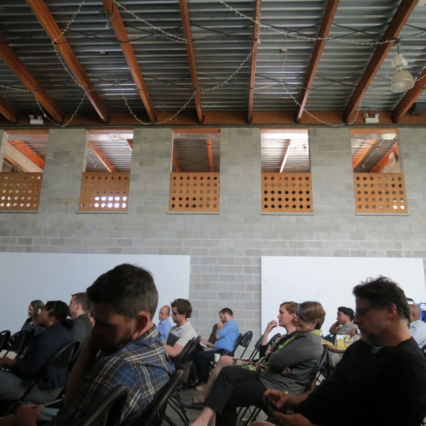 audience members listen at the Salvage 3.0 symposium