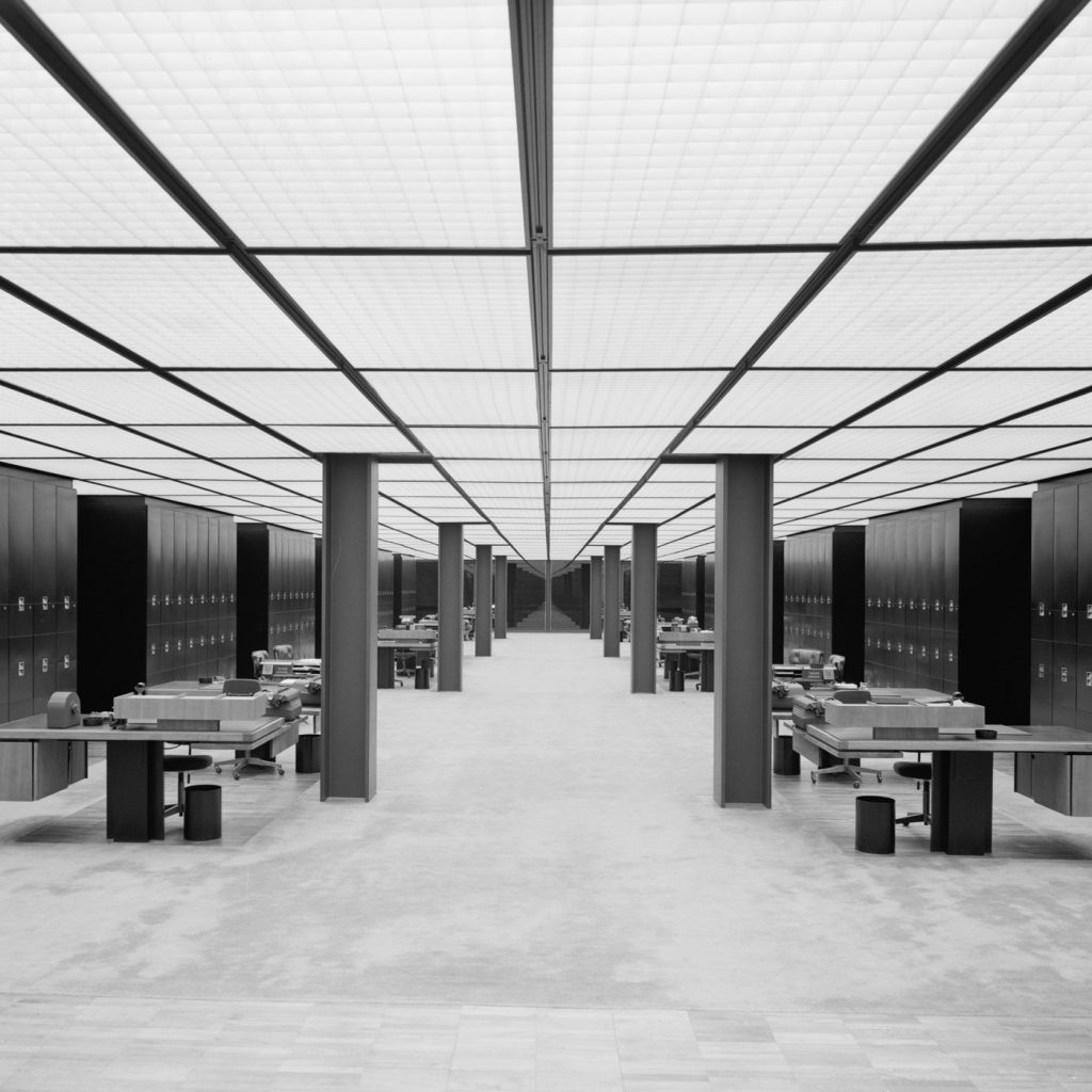 black and white image of large empty office space