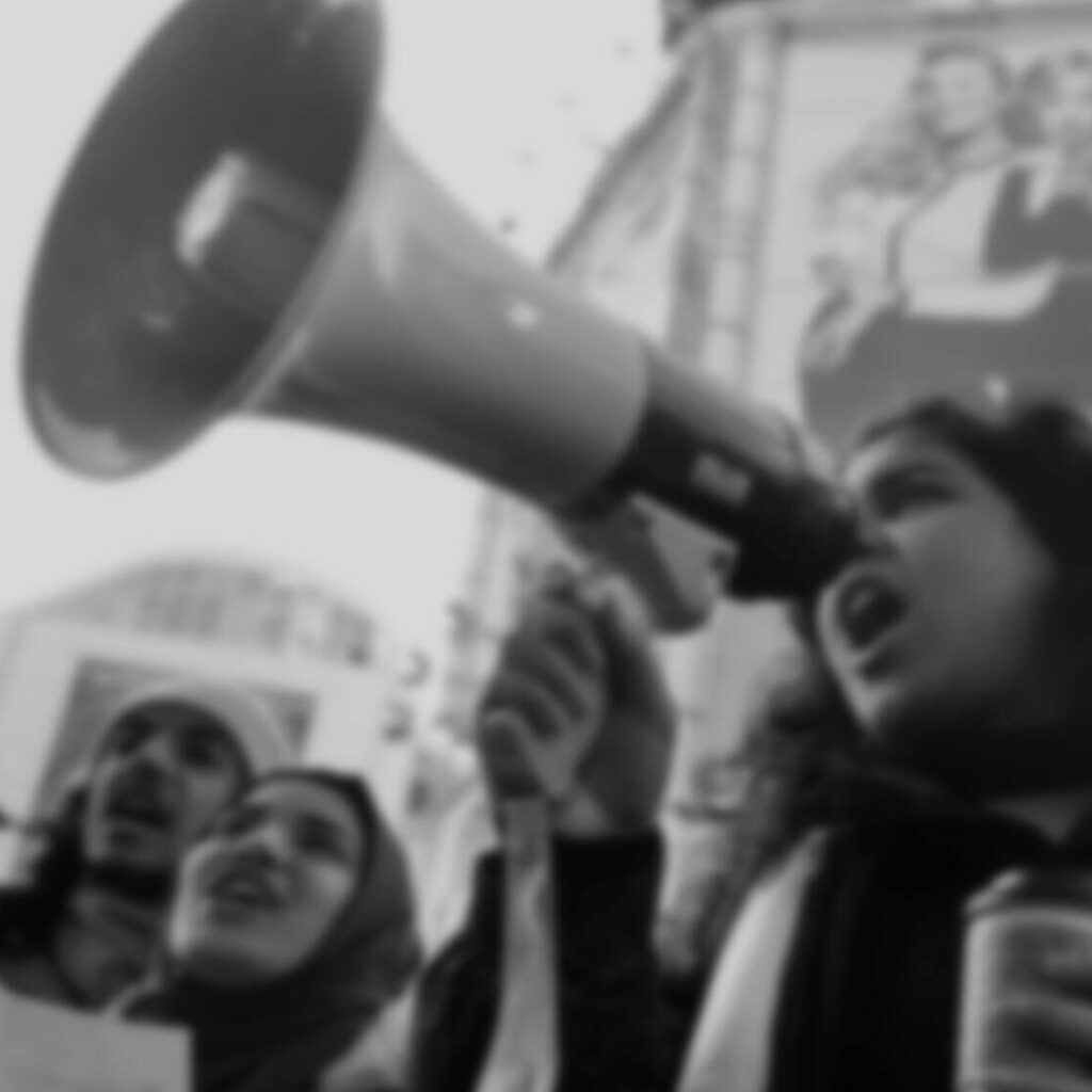 woman with megaphone in a city